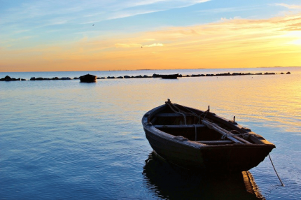 Small fishing boats at sunset - Photo by Eckhard Wolfgramm